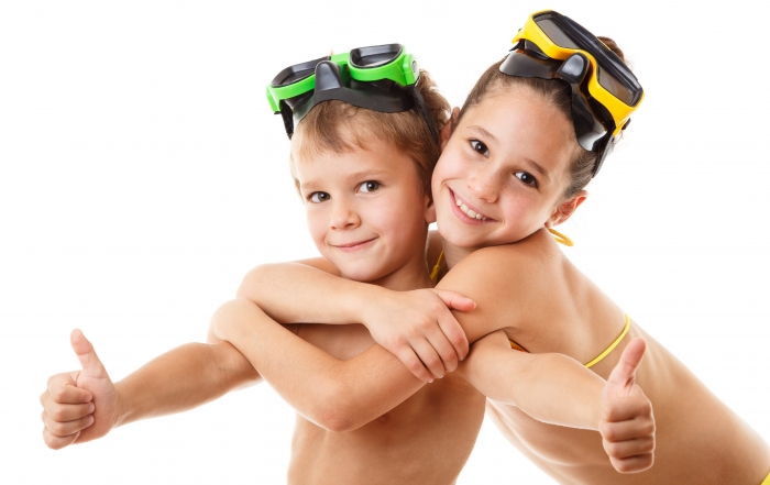 Two happy kids in diving masks